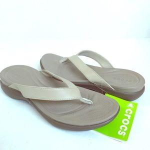 Crocs tan flip flops NWT 8